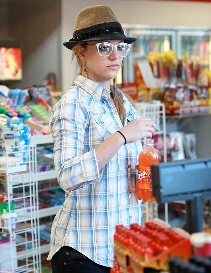 "You know there's something terribly wrong when Britney's cutest accessory is her tasty beverage. RS/<a href=""http://www.x17online.com"" target=""new"">X17 Online</a> - December 14, 2009"