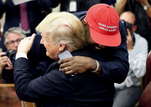 PHOTO: President Donald Trump hugs rapper Kanye West during a meeting in the Oval office of the White House on Oct. 11, 2018 in Washington, D.C. (Oliver Contreras/Getty Images)