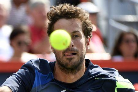 Aug 12, 2017; Montreal, Quebec, Canada; Robin Haase of the Netherlands hits a forehand against Roger Federer of Switzerland (not pictured) during the Rogers Cup tennis tournament at Uniprix Stadium. Mandatory Credit: Eric Bolte-USA TODAY Sports