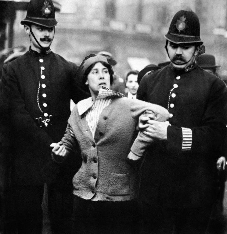 A female suffragette being lead away by police [Photo: PA Images]