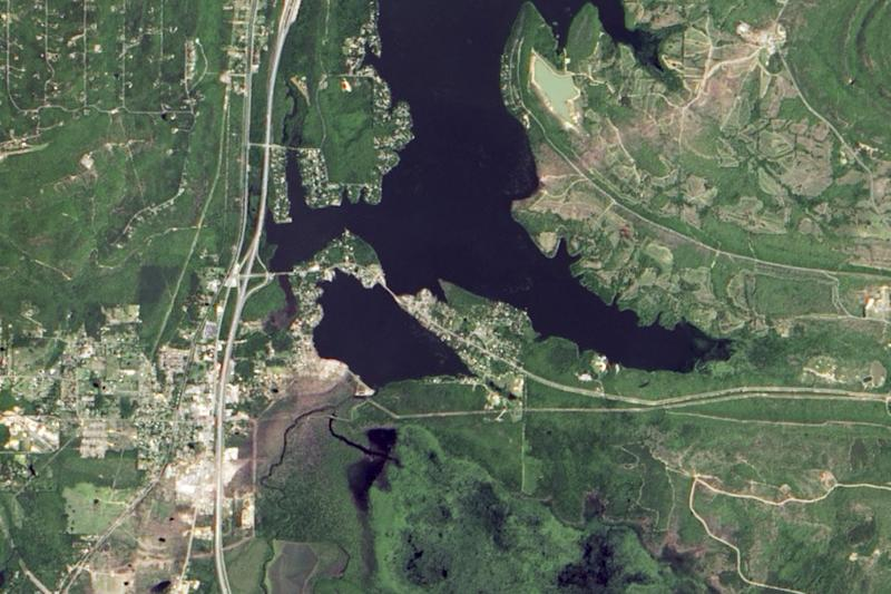 In this photo provided by NASA, taken from space by NASA's Earth Observatory May 2, 2014, the town of Mayflower, Ark., lower left, is shown six days after an EF4 tornado passed through the area. The storm's track can be seen trailing to the northeast, upper right, of the picture. (AP Photo/NASA Earth Observatory)