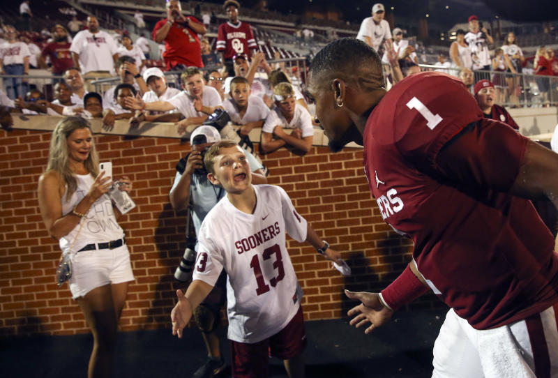 Sep 1, 2019; Norman, OK, USA; Oklahoma Sooners quarterback Jalen Hurts (1) high fives a fan after the game against the Houston Cougars at Gaylord Family - Oklahoma Memorial Stadium. Mandatory Credit: Kevin Jairaj-USA TODAY Sports