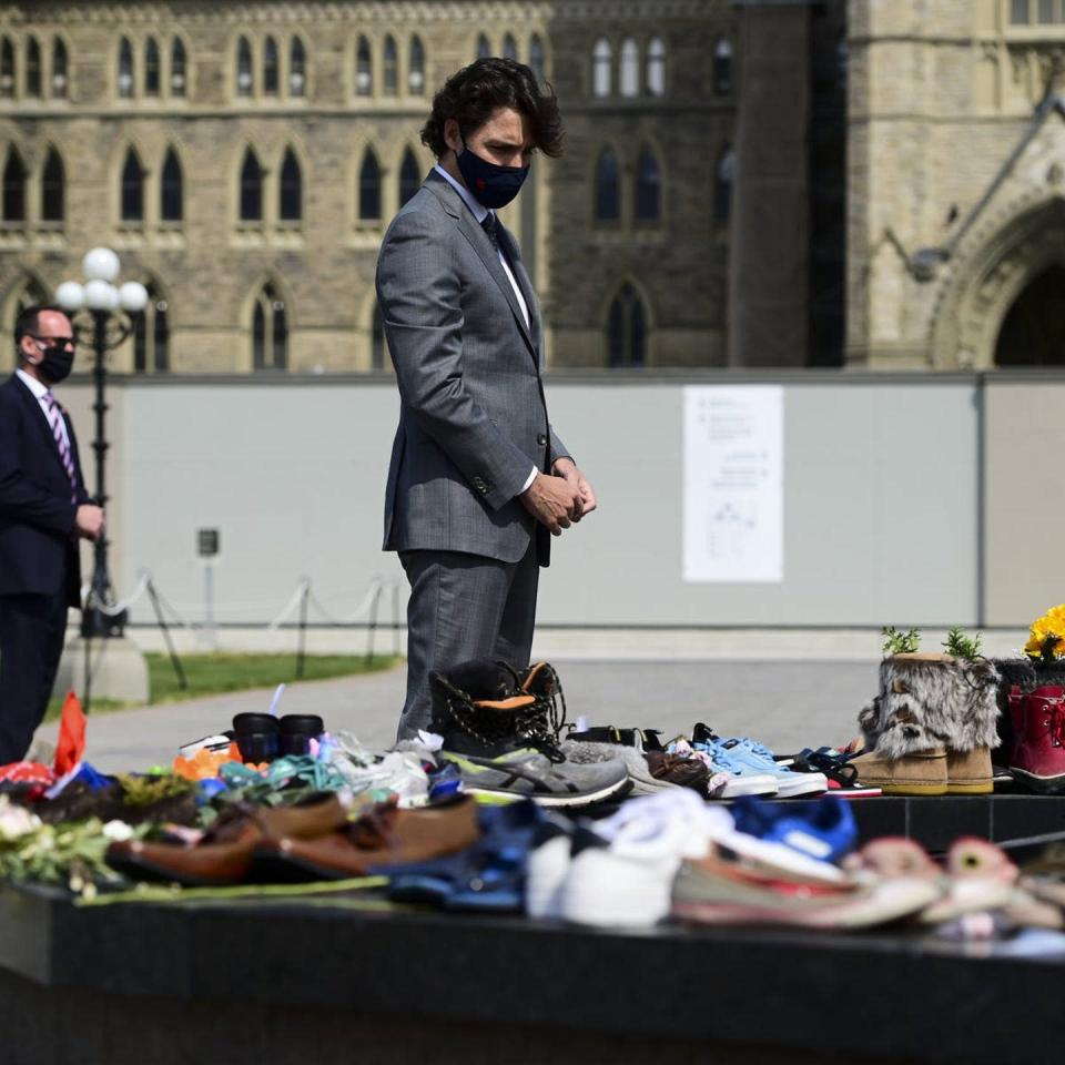 """<span class=""""caption"""">PM Trudeau paying tribute to the 215 children whose bodies were found at the site of the former Kamloops Indian Residential School in British Columbia.</span>"""