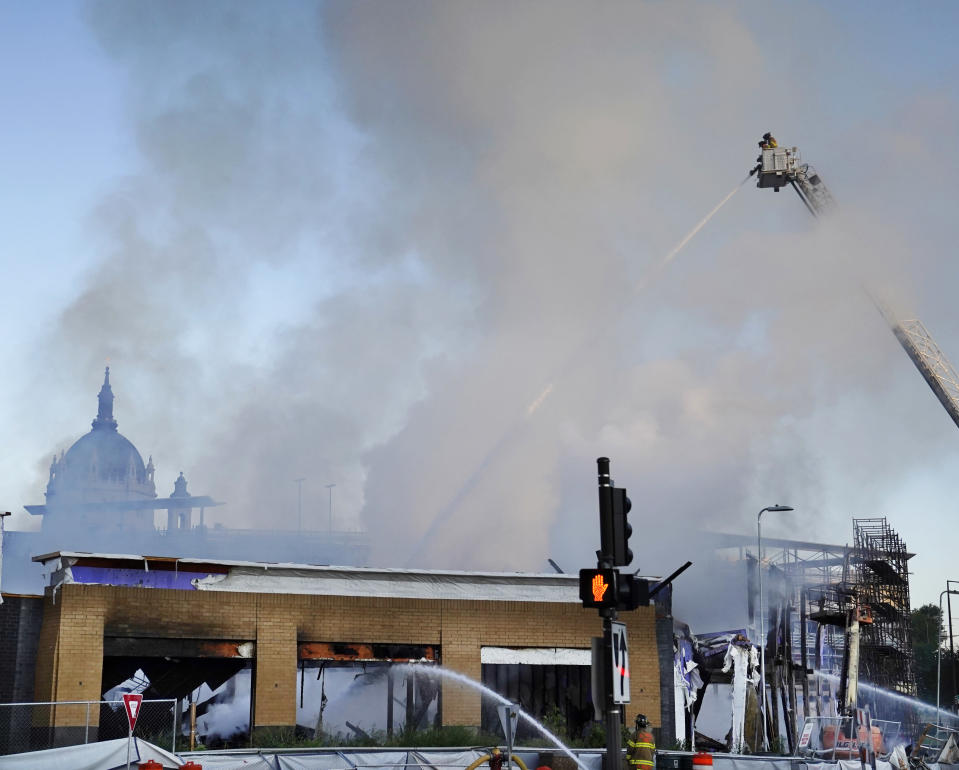 Firefighters battle a fire in downtown St. Paul, Minn., that has engulfed a building that was under construction on Tuesday, Aug. 4, 2020. There were no reports of injuries and there was no immediate word about the possible cause of the fire. (David Joles/Star Tribune via AP)