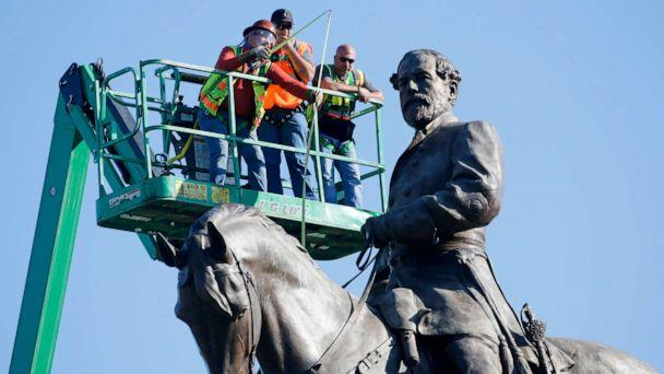PHOTO: An inspection crew from the Virginia Department of General Services takes measurements as they inspect the statue of Confederate Gen. Robert E. Lee on Monument Avenue, June 8, 2020, in Richmond, Va. (Steve Helber/AP)