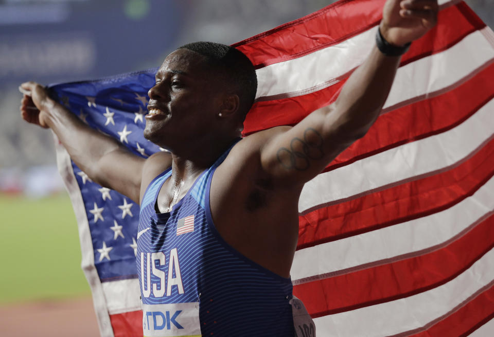 Christian Coleman, of the United States, celebrates winning the gold medal in the men's 100m final at the World Athletics Championships in Doha, Qatar, Saturday, Sept. 28, 2019. (AP Photo/Nariman El-Mofty)