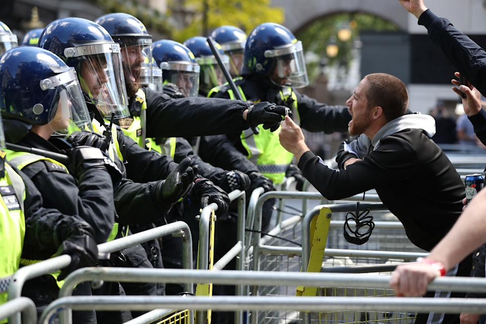 Police are confronted by protesters in Whitehall near Parliament Square, London, during a protest by the Democratic Football Lads Alliance against a Black Lives Matter protest.