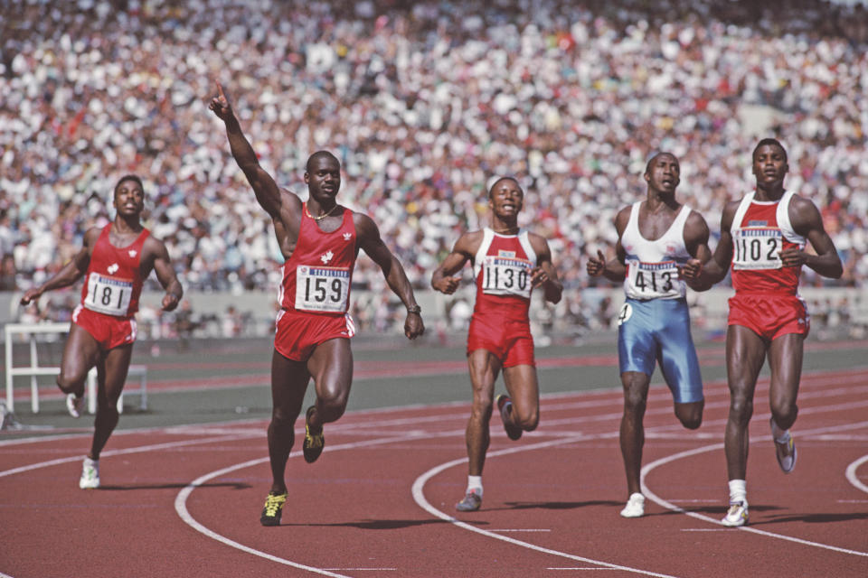 Canada sprinter Ben Johnson (second from left) celebrates winning the men's 100m in world-record time at the 1988 Seoul Olympics. He would later be disqualified for taking performance-enhancing drugs.