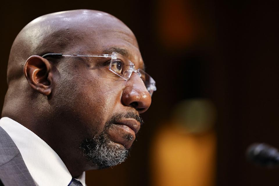 Senator Raphael Warnock (D-GA) testifies during a Senate Judiciary Committee hearing on voting rights on Capitol Hill in Washington,DC on April 20, 2021. (Photo by EVELYN HOCKSTEIN / POOL / AFP) (Photo by EVELYN HOCKSTEIN/POOL/AFP via Getty Images)