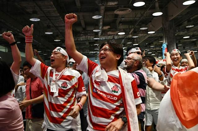 """History: Japan fans erupted at the """"fanzone"""" after the team beat Scotland (AFP Photo/Anne-Christine POUJOULAT)"""