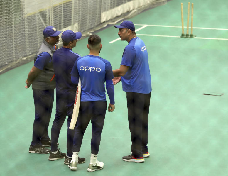 India's captain Virat Kohli, second right, listens to team coach Ravi Shastri, right, as he interacts with bowling coach Bharat Arun, left, and batting coach Sanjay Bangar during an indoor training session ahead of their Cricket World Cup match against West Indies at Old Trafford in Manchester, England, Tuesday, June 25, 2019. (AP Photo/Aijaz Rahi)