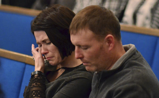 <p>A woman wipes tears from her eye during a prayer vigil at Briensburg Baptist Church near Benton, Ky., Jan. 23, 2018. Bailey Nicole Holt and Preston Ryan Cope, both 15, were killed and another 17 people injured when a classmate opened fire Tuesday morning in the Marshall County High School atrium, a common area at the school where several hallways meet and students gather before classes. (Photo: Stephen Lance Dennee/AP) </p>