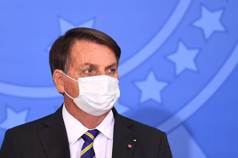 Brazilian President Jair Bolsonaro attends the launch of the Rural Women's Rights program at Planalto Palace in Brasilia, on July 29, 2020. - This is the first public appearance of Bolsonaro in an official event after he tested negative for COVID-19 coronavirus. (Photo by EVARISTO SA / AFP) (Photo by EVARISTO SA/AFP via Getty Images)
