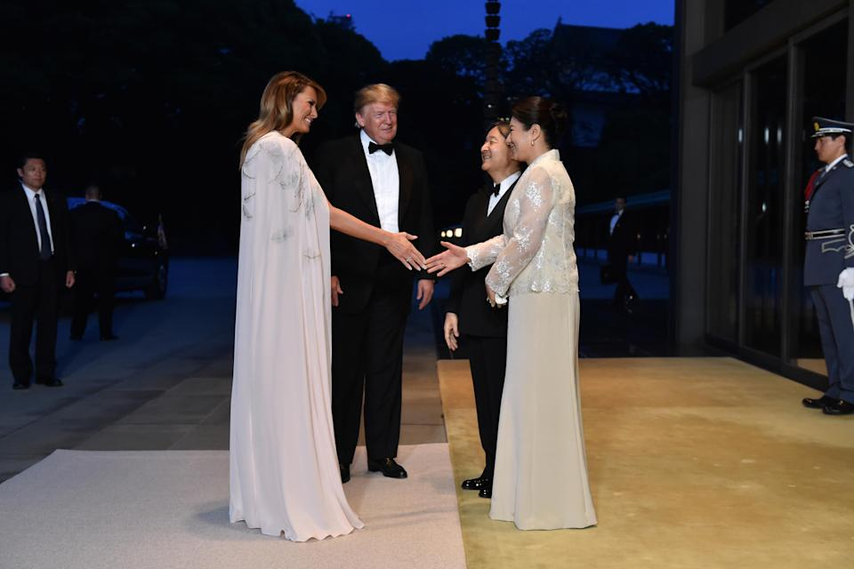 For a lavish banquet at the Imperial Palace, Trump decided to fly the US flag in a £3,500 feather-emblazoned dress by American designer J. Mendel. [Photo: Getty]