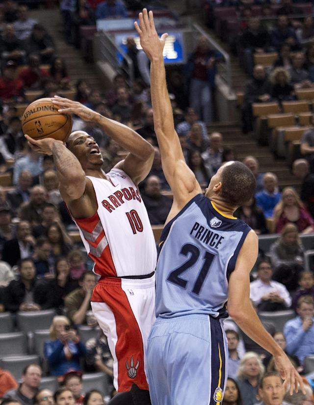Toronto Raptors forward DeMar DeRozan, left, tries for a jump shot past Memphis Grizzlies forward Tayshaun Prince (21) during first half NBA basketball action in Toronto on Friday, March. 14, 2014. (AP Photo/The Canadian Press, Nathan Denette)