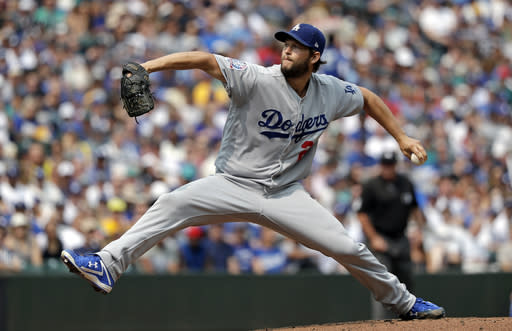 Los Angeles Dodgers starting pitcher Clayton Kershaw throws against the Seattle Mariners in the first inning of a baseball game Sunday, Aug. 19, 2018, in Seattle. (AP Photo/Elaine Thompson)