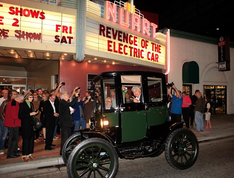 Jay Leno arrives in his 1909 Baker Electric car at
