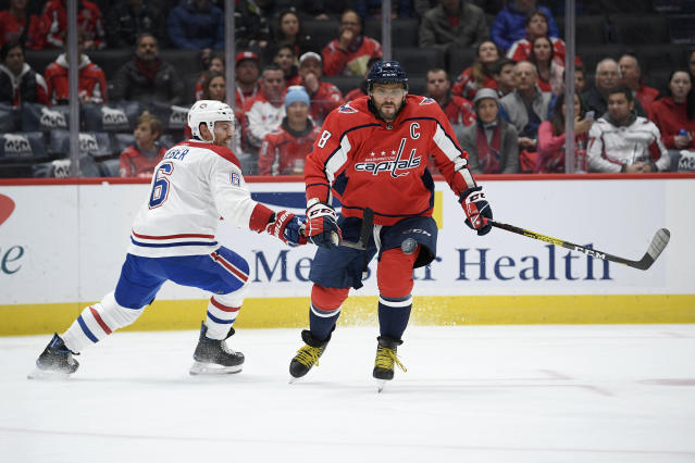 Washington Capitals left wing Alex Ovechkin (8), of Russia, chases the puck past Montreal Canadiens defenseman Shea Weber (6) during the first period of an NHL hockey game, Friday, Nov. 15, 2019, in Washington. (AP Photo/Nick Wass)