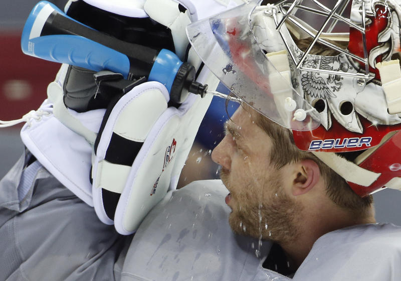 Russia goaltender Semyon Varlamov sprays water on his face during a training session at the Bolshoy Ice Dome at the the 2014 Winter Olympics, Tuesday, Feb. 11, 2014, in Sochi, Russia. (AP Photo/Julio Cortez)