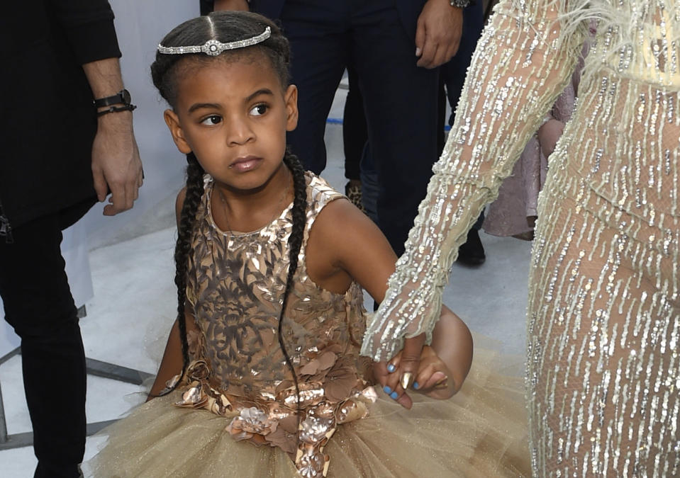 """FILE - In this Aug. 28, 2016 file photo, Blue Ivy, daughter of Beyonce, arrives at the MTV Video Music Awards at Madison Square Garden in New York. At just 7, Blue Ivy Carter is an award-winning songwriter. Jay-Z and Beyoncé's daughter won the Ashford & Simpson Songwriter's Award at the Soul Train Awards on Sunday, Nov 17, 2019, for co-writing her mom's hit """"Brown Skin Girl,"""" a song celebrating dark- and brown-skinned women. Ivy gives a vocal performance that opens and closes the song, which also features Wizkid and Saint Jhn.(Photo by Chris Pizzello/Invision/AP, File)"""