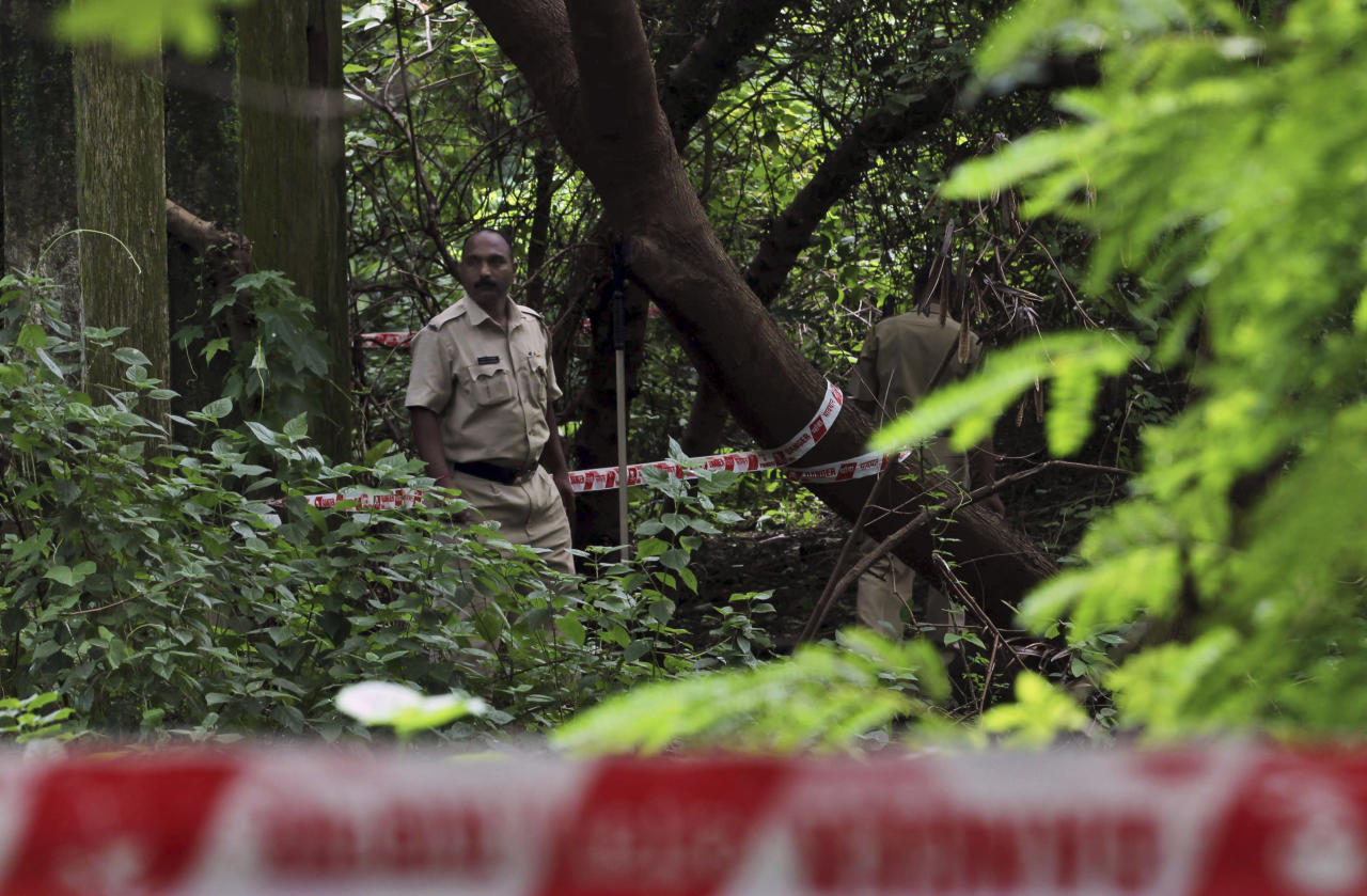 Indian policemen inspect the site where a 22-year-old woman was gang raped in Mahalaxmi area in Mumbai India, Friday, Aug. 23, 2013. The young woman photojournalist was gang raped while her male colleague was tied up and beaten in India's business hub of Mumbai, police said Friday. The case was reminiscent of the December gang rape and death of a young university student in the Indian capital that shocked the country. (AP Photo/Rafiq Maqbool)