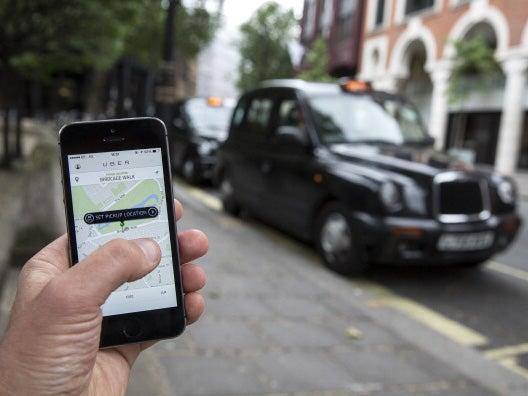 Smatphone app used to order an Uber cab (Oli Scarff/Getty Images)