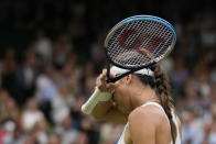 Australia's Ajla Tomljanovic wipes her brow during the women's singles quarterfinals match against compatriot Ashleigh Barty on day eight of the Wimbledon Tennis Championships in London, Tuesday, July 6, 2021. (AP Photo/Kirsty Wigglesworth)