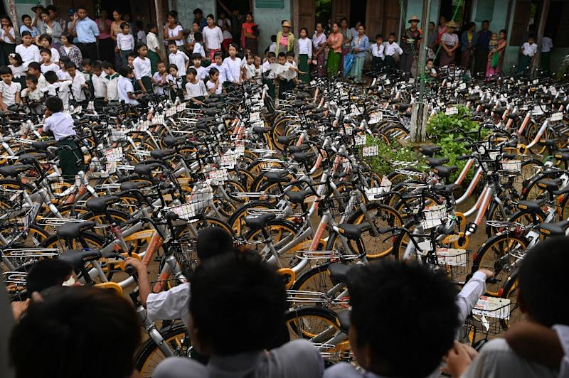 The aim is to keep up momentum and hand out a total of 100,000 bikes over five years (AFP Photo/Ye Aung THU)