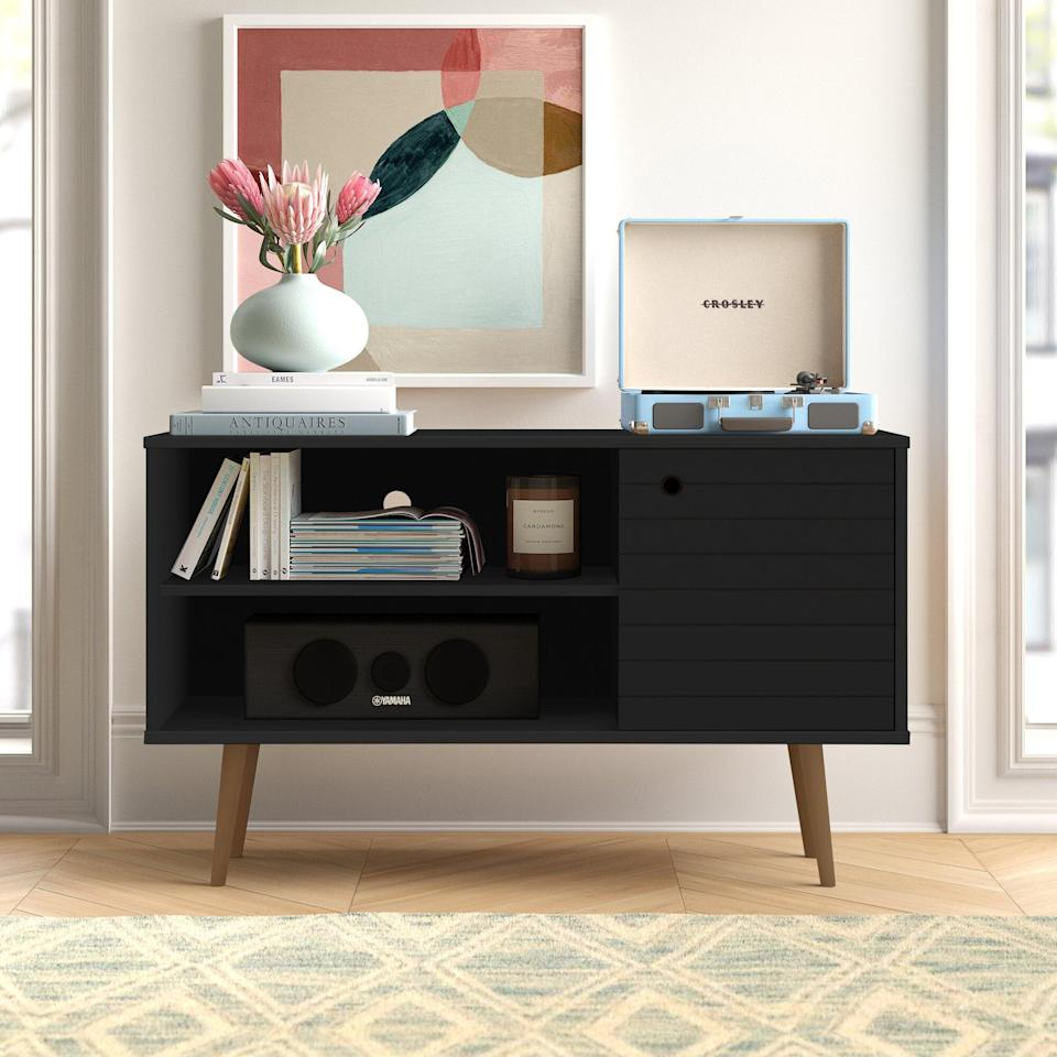 <p>This <span>Hayward TV Stand</span> ($140, originally $349) is great as a music station.</p>