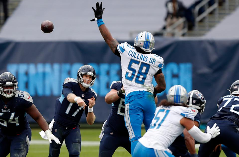 Quarterback Ryan Tannehill (17) of the Tennessee Titans throws a pass over outside linebacker Jamie Collins (58) of the Detroit Lions during the second quarter of the game at Nissan Stadium on Dec. 20, 2020 in Nashville, Tennessee.