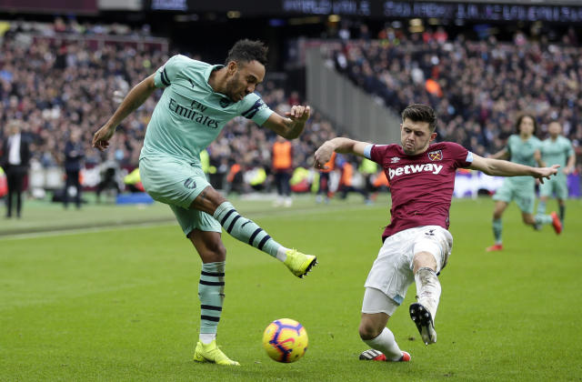 Arsenal's Pierre-Emerick Aubameyang attempts a shot during the English Premier League soccer match between West Ham United and Arsenal at London Stadium in London, Saturday, Jan. 12, 2019. (AP Photo/Tim Ireland)