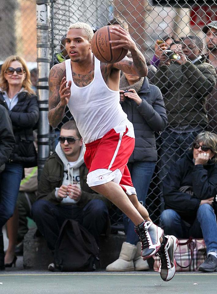 "Just hours after he allegedly trashed his dressing room as a result of being questioned about his 2009 arrest for assaulting ex-girlfriend Rihanna on ""Good Morning America"" Tuesday, singer Chris Brown worked out his anger by hitting a basketball court in NYC. Law enforcement sources told TMZ that ABC has decided not to press charges against Brown for the damage caused. PPNY/GSNY/<a href=""http://www.splashnewsonline.com"" target=""new"">Splash News</a> - March 22, 2011"
