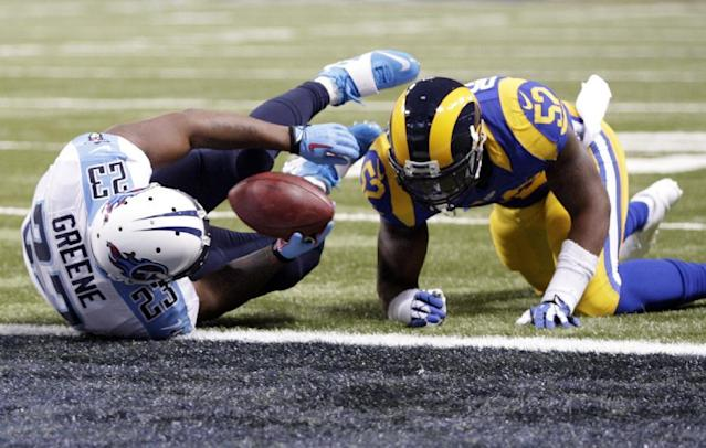 Tennessee Titans running back Shonn Greene, left, falls into the end zone at the end of a 5-yard touchdown run as St. Louis Rams linebacker Alec Ogletree watches during the first quarter of an NFL football game Sunday, Nov. 3, 2013, in St. Louis. (AP Photo/Tom Gannam)