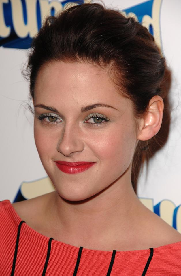 "<p>Stewart attended the premiere of ""Adventureland"" in 2009 wearing a playful shade of eyeshadow and a bold red lip.</p>"