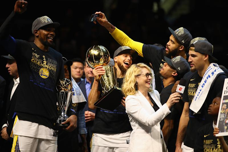 NBA analyst Doris Burke pictured alongside the Golden State Warriorsafter the team defeated the Cleveland Cavaliers in the 2018 NBA Finals. (Gregory Shamus via Getty Images)
