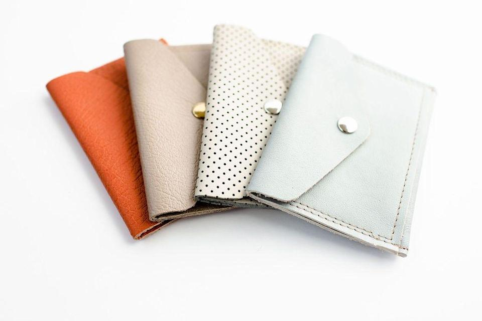 Leather wallets like these made by Mend on the Move, will be the kinds of products the non-profit organization  in Detroit will make with thousands of dollars in car seat leather donated Ford Motor Co. Sales of the leather goods benefit survivors of abuse.