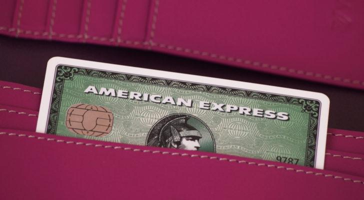 an American Express (AXP) credit card sticking out of someone's pocket