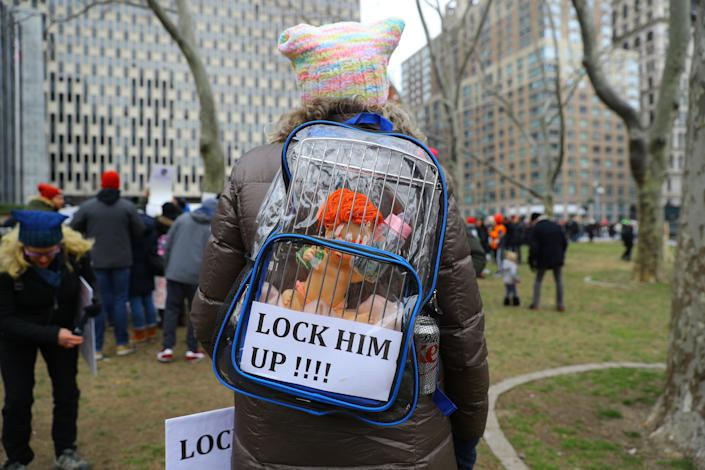 A women carries a clear backpack with a caged Trump baby doll with a bottle at the Women's Unity Rally hosted by a chapter of Women's March National on Jan. 19, 2019 at Foley Square in New York City. (Photo: Gordon Donovan/Yahoo News)