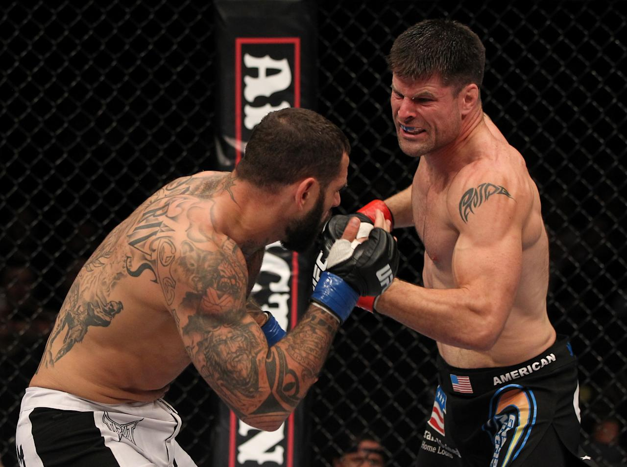 STOCKHOLM, SWEDEN - APRIL 14: (R-L) Brian Stann punches Alessio Sakara during their middleweight bout at the UFC on Fuel TV event at Ericsson Globe on April 14, 2012 in Stockholm, Sweden. (Photo by Josh Hedges/Zuffa LLC/Zuffa LLC via Getty Images)
