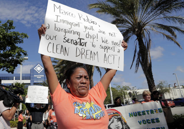 <p>Antonia Catalan marches outside of the office of Sen. Marco Rubio, R-Fla., in support of Deferred Action for Childhood Arrivals (DACA), and Congress passing a clean Dream Act, Monday, Jan. 22, 2018, in Doral, Fla. (Photo: Lynne Sladky/AP) </p>
