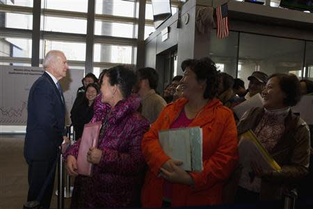 U.S. Vice President Biden talks to visa applicants at U.S. Embassy Consular Section in Beijing