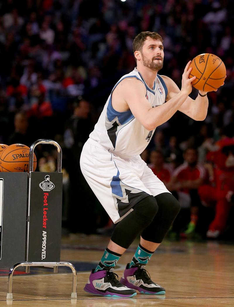 Kevin Love of the Minnesota Timberwolves competes during the Foot Locker Three-Point Contest 2014 on February 15, 2014 in New Orleans, Louisiana