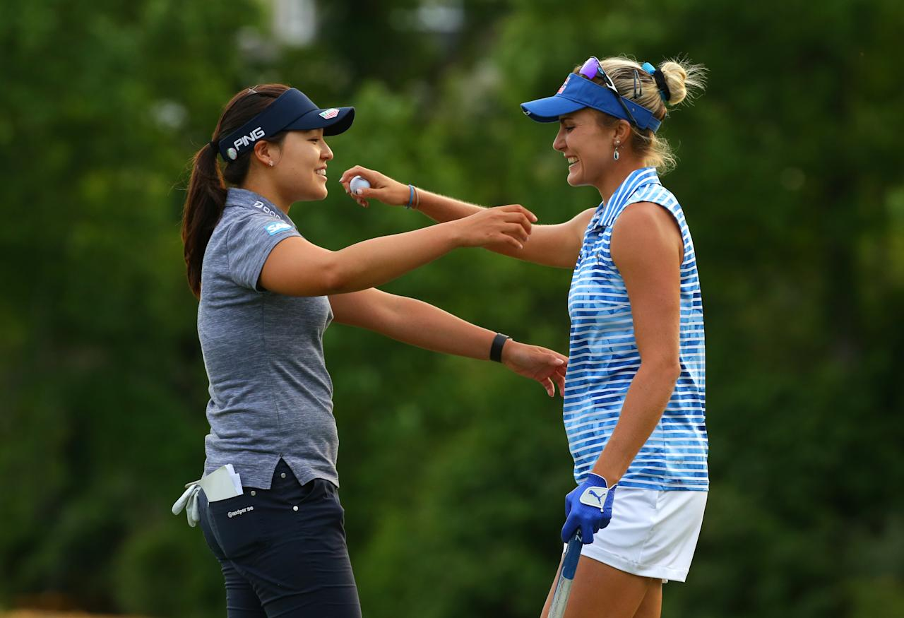Winner Lexi Thompson and runner-up Chun in-Gee hug after the final round of the Kingsmill Championship (AFP Photo/Hunter Martin)