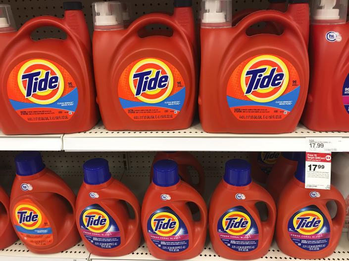 Procter & Gamble's Tide laundry detergent fills the shelves of a department store on Thursday, June 14, 2018, in Aventura, Fla. (AP Photo/Brynn Anderson)