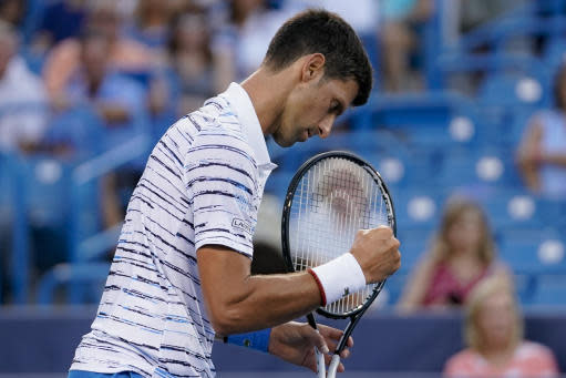 Novak Djokovic, of Serbia, reacts during a match against Pablo Carreno Busta, of Spain, during the quarterfinals of the Western & Southern Open tennis tournament Thursday, Aug. 15, 2019, in Mason, Ohio. (AP Photo/John Minchillo)