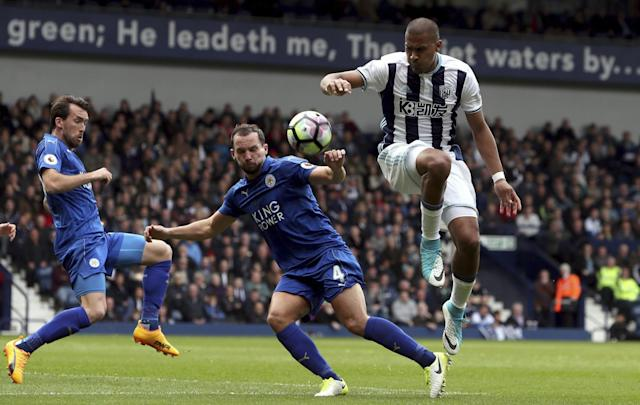 <p>West Bromwich Albion's Jose Salomon Rondon, right, and Leicester City's Danny Drinkwater </p>