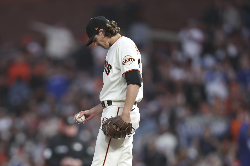 San Francisco Giants pitcher Kevin Gausman reacts on the mound during the second inning of Game 2 of a baseball National League Division Series against the Los Angeles Dodgers Saturday, Oct. 9, 2021, in San Francisco. (AP Photo/Jed Jacobsohn)