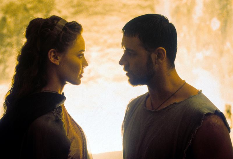 Connie Nielsen looking into the eyes of Russell Crowe in a scene from the film 'Gladiator', 2000. (Photo by Universal/Getty Images)