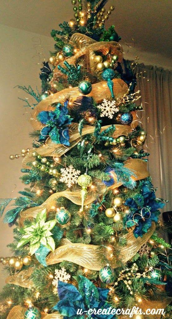 """<p>If you're looking for a Christmas tree that throws all tradition out the window and still makes for a breathtaking sight, you've found it. You've never seen a tree like this one. </p><p><strong><em>Get the tutorial at <a href=""""https://www.u-createcrafts.com/michaels-dream-tree-challenge/"""" rel=""""nofollow noopener"""" target=""""_blank"""" data-ylk=""""slk:U Create Crafts"""" class=""""link rapid-noclick-resp"""">U Create Crafts</a>.</em></strong></p><p><a class=""""link rapid-noclick-resp"""" href=""""https://www.amazon.com/Piokio-Natural-Feathers-Christmas-Decorations/dp/B07F6QWHQJ/?tag=syn-yahoo-20&ascsubtag=%5Bartid%7C10070.g.2025%5Bsrc%7Cyahoo-us"""" rel=""""nofollow noopener"""" target=""""_blank"""" data-ylk=""""slk:BUY PEACOCK FEATHERS"""">BUY PEACOCK FEATHERS</a><br></p>"""