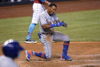 New York Mets' Johneshwy Fargas reacts after he was out at the plate during the 12th inning of the team's baseball game against the Miami Marlins, Friday, May 21, 2021, in Miami. The Mets won 6-5 in 12 innings. (AP Photo/Lynne Sladky)